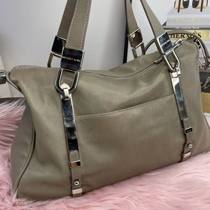 Michael Kors handcrafted taupe leather bag.